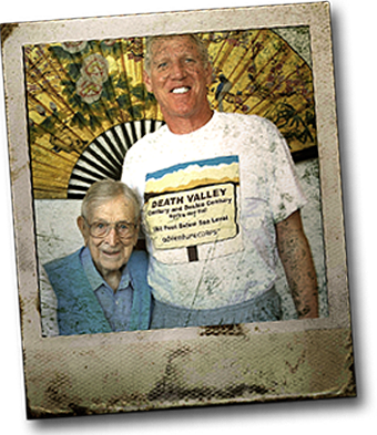 Adult Bill Walton next to aged Coach
