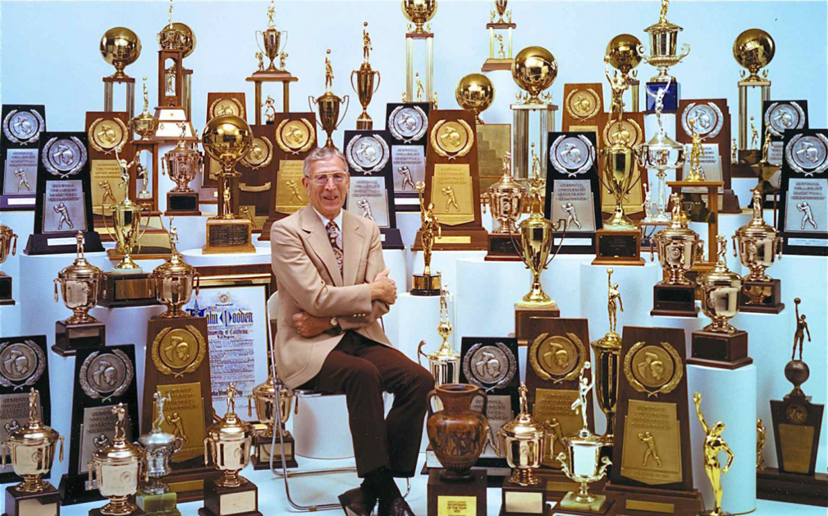 John Wooden with trophies