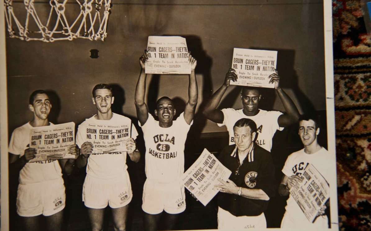 Nat. champ team holds newspapers